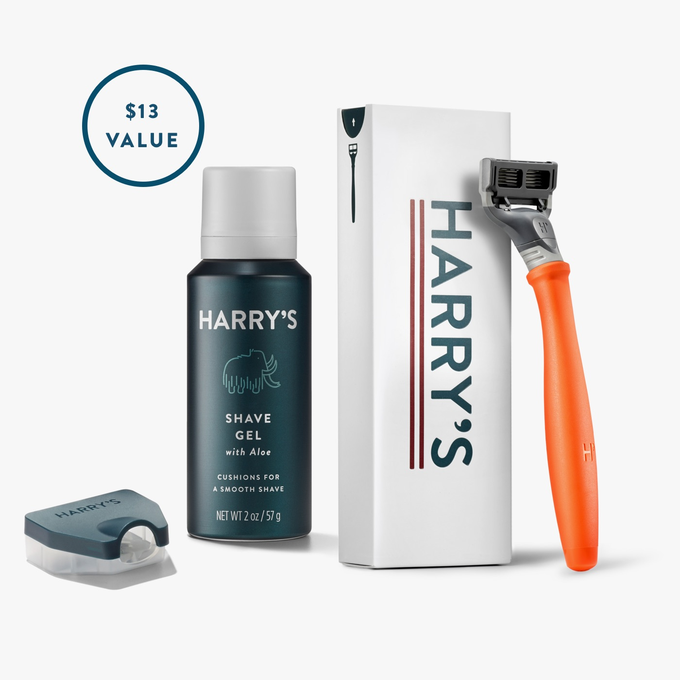Harry's Free Trial Set with foaming shave gel, orange truman razor handle, travel blade cover and packaging